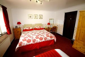 A bed or beds in a room at Eagles Guest House