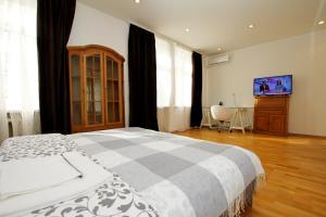 Кровать или кровати в номере TVST apartments on Tverskaya 6