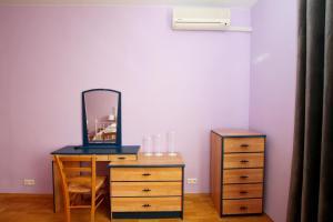 Телевизор и/или развлекательный центр в TVST apartments on Tverskaya 6