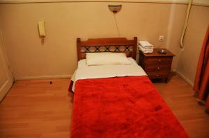 A bed or beds in a room at Argo
