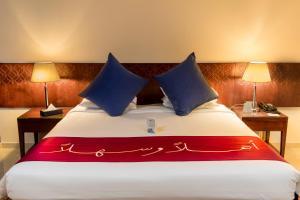 Cama ou camas em um quarto em Makarem Umm Al Qura Hotel