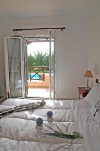 Letto o letti in una camera di Echinades Resort