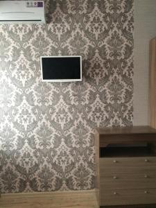 Телевизор и/или развлекательный центр в Guest House Ludmila