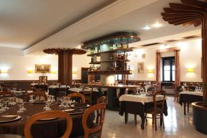 A restaurant or other place to eat at Hotel Belvedere