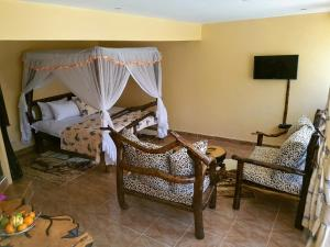 Ein Sitzbereich in der Unterkunft Karen Little Paradise