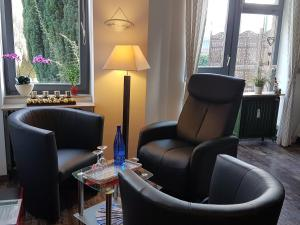 A seating area at Ferienwohnung Carpe Diem