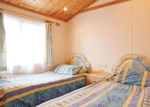 A bed or beds in a room at Searles Leisure Resort
