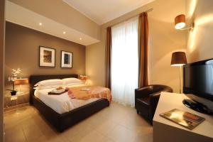 Cama ou camas em um quarto em Trianon Borgo Pio Aparthotel