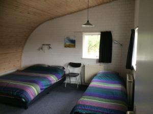 Een bed of bedden in een kamer bij Vlinderhuis 21B
