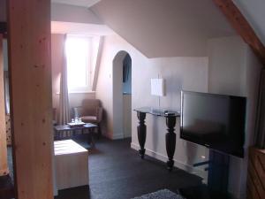 Télévision ou salle de divertissement dans l'établissement Chateau d'As