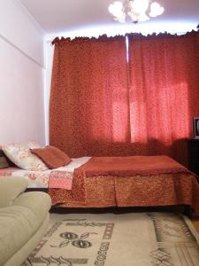 A bed or beds in a room at Apartment Generala Ermolova