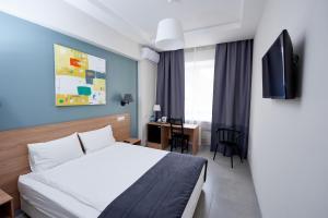 Кровать или кровати в номере Отель 41