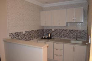 A cozinha ou cozinha compacta de Semac Apartment Hotel