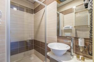 Een badkamer bij Hotel Port