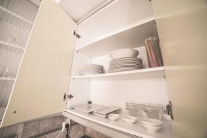 A kitchen or kitchenette at Nefeli City Apartments