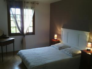 A bed or beds in a room at Holiday home Les salines