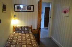 A bed or beds in a room at The Quaich B&B