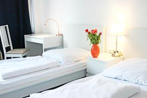 A bed or beds in a room at MAC City Hostel