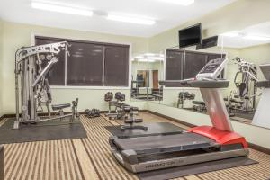 The fitness centre and/or fitness facilities at Ramada by Wyndham Carlyle