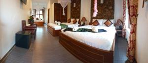 A bed or beds in a room at Darica Resort