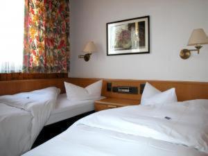 Кровать или кровати в номере Hotel Gasthof Vogelsang