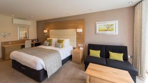 A bed or beds in a room at The Park Hotel