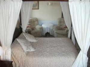 A bed or beds in a room at Falcons Nest Hotel