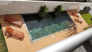 A view of the pool at Flic en Flac Beach Apartment or nearby