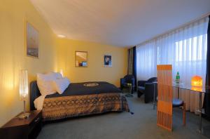 A bed or beds in a room at City Apartments Regence