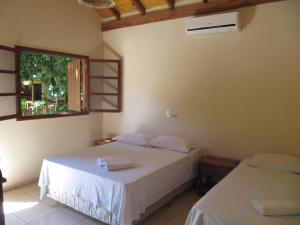 A bed or beds in a room at Eco Pousada Villa Verde