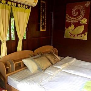 A bed or beds in a room at Panpim Resort