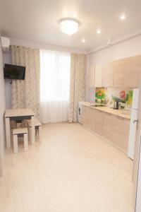A kitchen or kitchenette at Sochi Sakvoyage Apartments