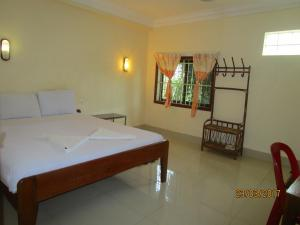 A bed or beds in a room at Visal Sak Guesthouse
