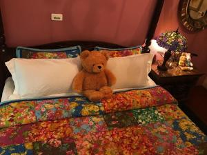 A bed or beds in a room at Hualien Paris Home B&B