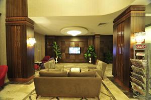 The lobby or reception area at Grand Cenas Hotel