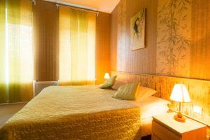 Кровать или кровати в номере Отель Антураж