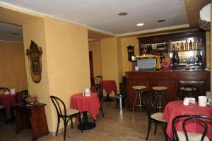 The lounge or bar area at Hotel Valentini Inn