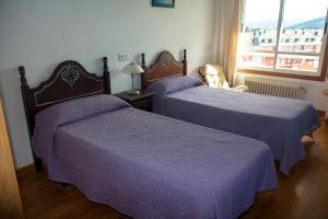 A bed or beds in a room at Hospedaxe Carragal