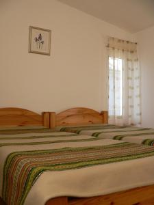 A bed or beds in a room at Guest House Maija