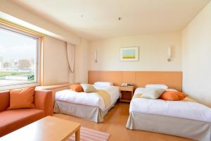 A bed or beds in a room at Sapporo Park Hotel