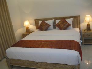 Ein Bett oder Betten in einem Zimmer der Unterkunft Temuku Guest House