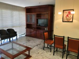 A television and/or entertainment centre at Sateltour Apart Hotel