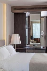 A bed or beds in a room at Aqua Blu Boutique Hotel & Spa, Adults Only- Small Luxury Hotels of the World
