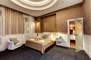 Кровать или кровати в номере Saint Yard Arbat