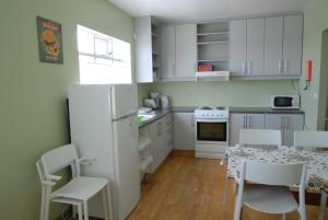 A kitchen or kitchenette at Grundarfjördur Hostel