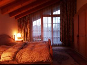 A bed or beds in a room at Haus Erika