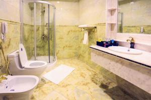 Um banheiro em Hala Inn Arar Hotel