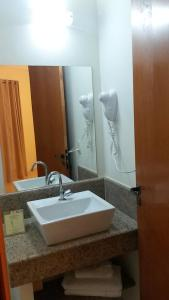 Ванная комната в Itajubá Flat Hotel