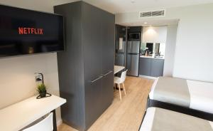A television and/or entertainment center at Studio 8 Residences - Adults Only