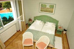 Letto o letti in una camera di Il Villino